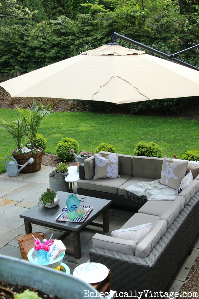 Love this outdoor sectional sofa with cantilevered umbrella kellyelko.com