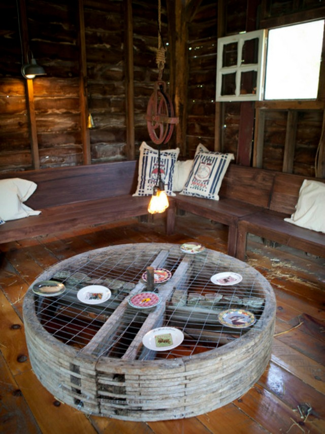 Rustic barn - love the exposed wood and the wrap around bench kellyelko.com