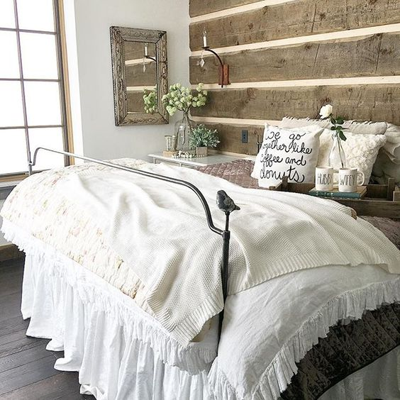 Rustic wood plank walls in this cozy master bedroom and love the little bird on the iron bed kellyelko.com