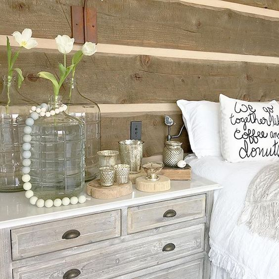 Love the rustic wood walls in this farmhouse bedroom kellyelko.com
