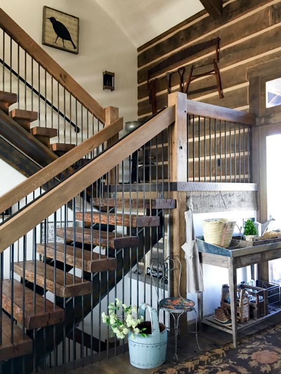 Love the rustic wood walls in this farmhouse foyer kellyelko.com