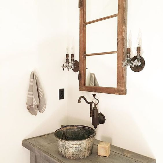 Use an old galvanized bucket as a sink kellyelko.com