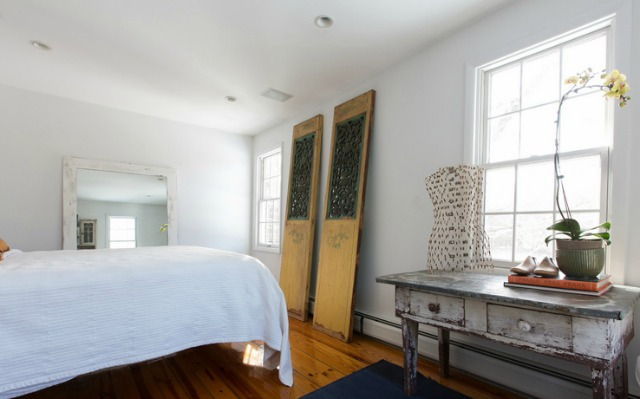 Vintage doors make the perfect art in this cozy bedroom kellyelko.com
