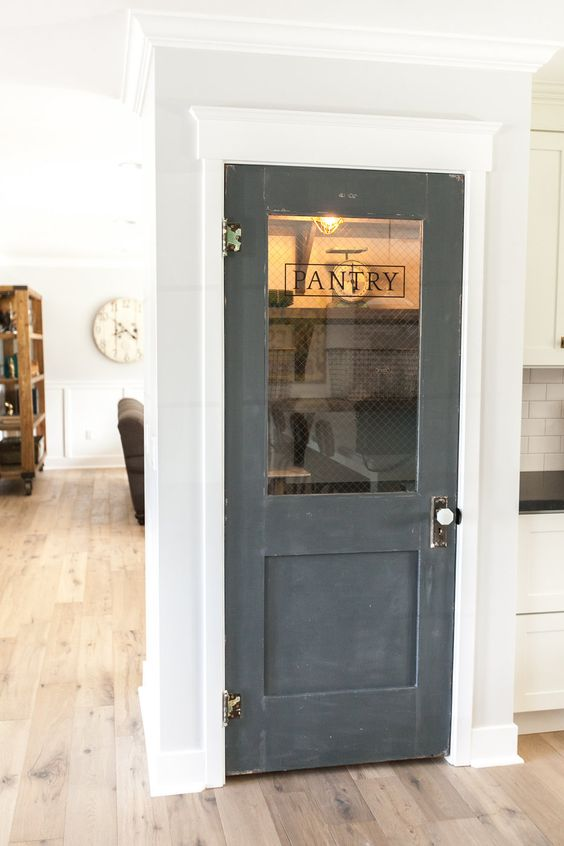 Use an old door to add character to a new home - love this pantry door kellyelko.com