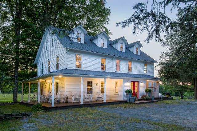Tour the Cooper Boone farm - a modern take on a classic farmhouse and big red barn kellyelko.com