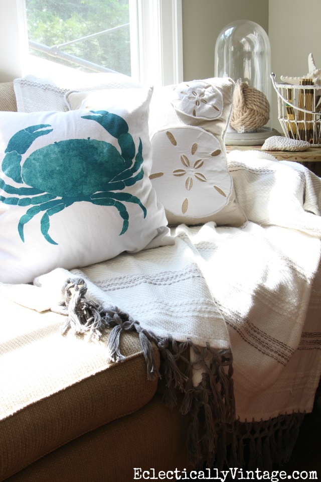 Love the neutral pillows and throw with the fun blue crab pillow kellyelko.com