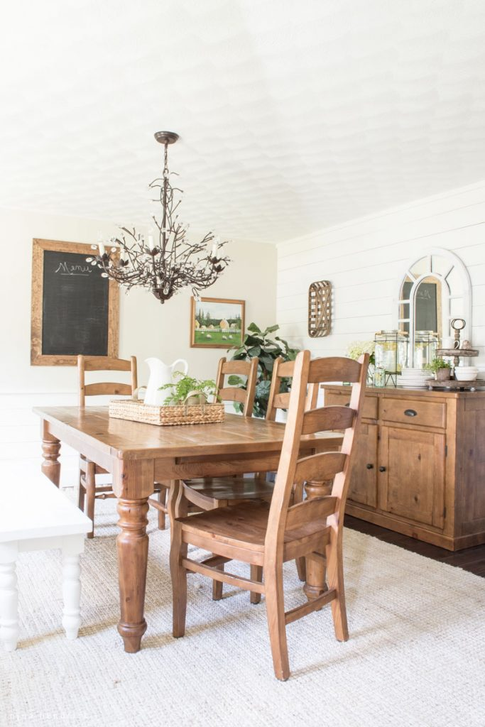 Farmhouse dining room with DIY planked walls kellyelko.com