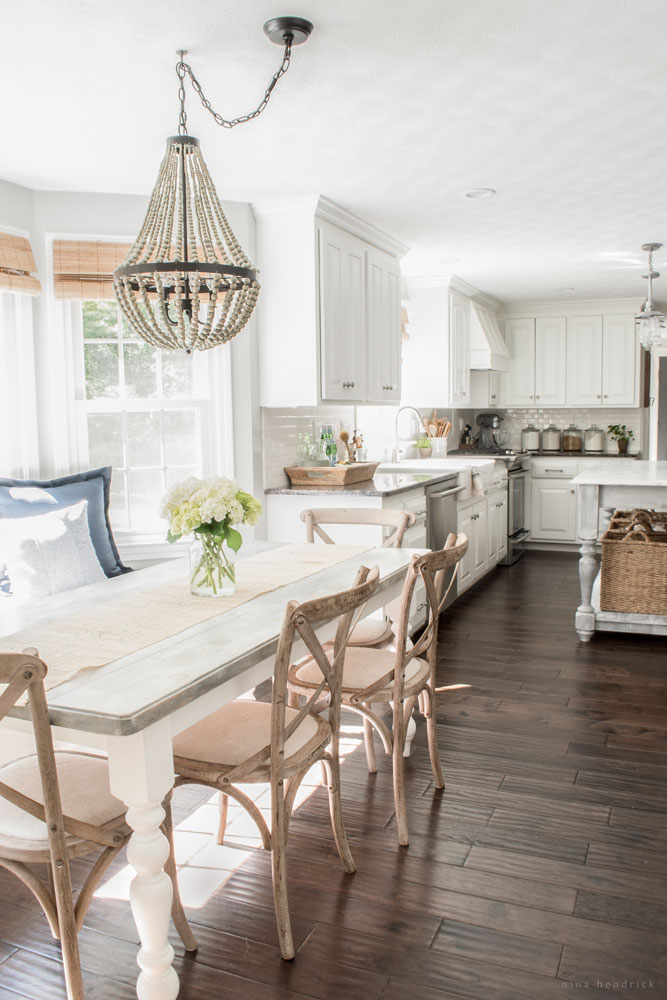 Farmhouse kitchen - love the mismatched furniture and beaded chandelier kellyelko.com