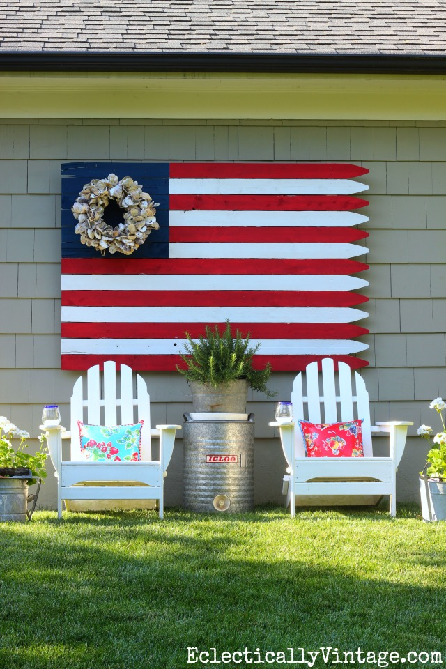 Love this patriotic flag made from a fence and the wreath instead of stars kellyelko.com