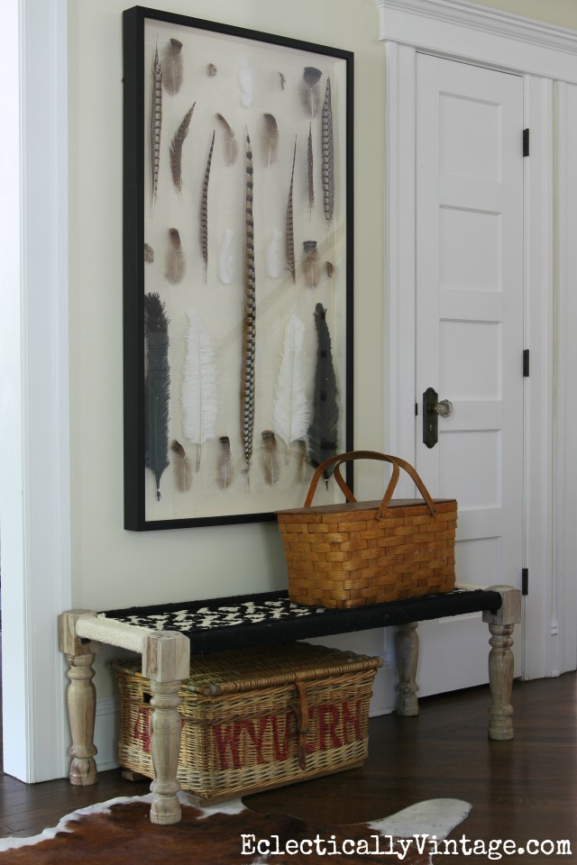 Love this giant shadowbox of feathers and the woven bench and baskets in this foyer kellyelko.com