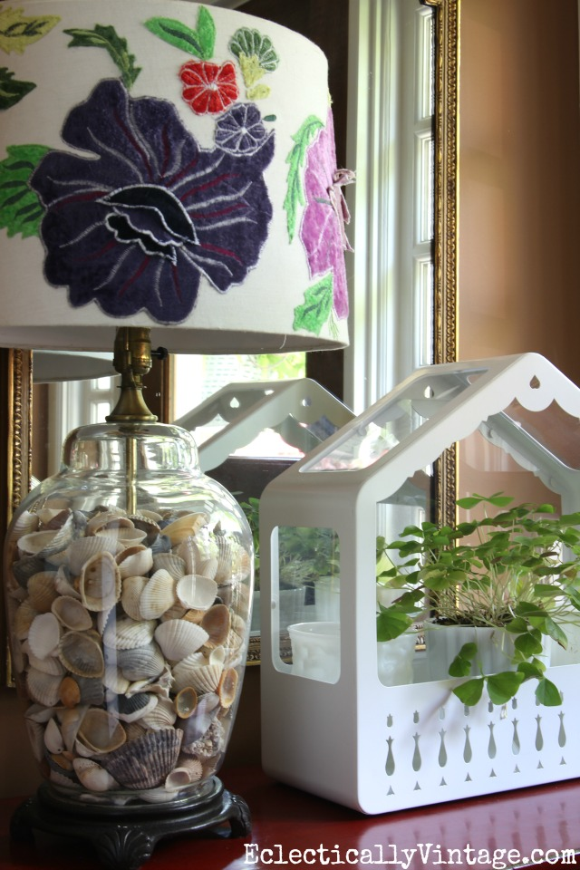 Love this glass lamp filled with shells kellyelko.com