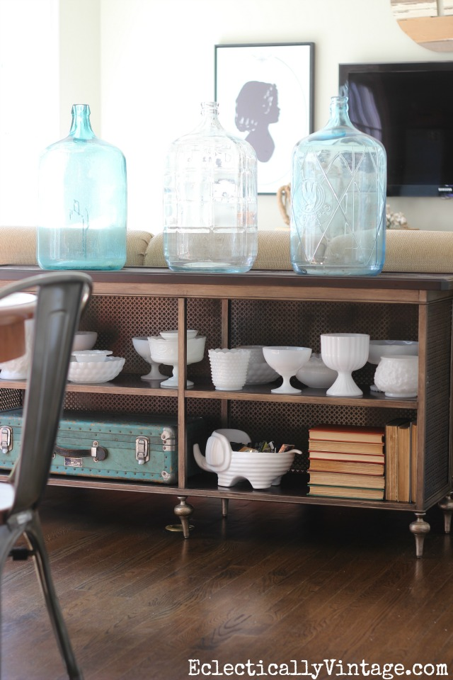Love the glass water jugs and vintage milk glass collections kellyelko.com