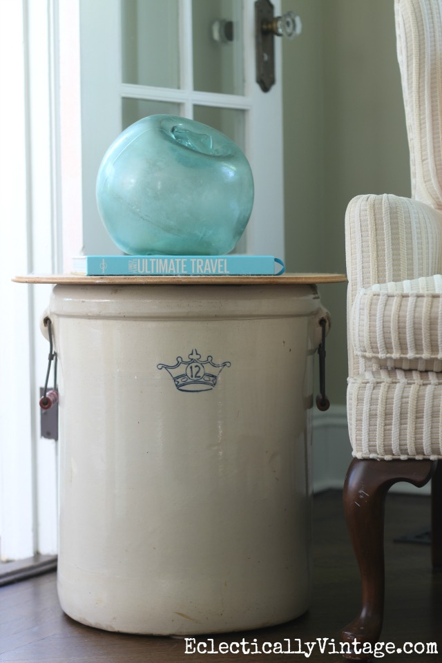 Vintage crock makes a unique side table kellyelko.com