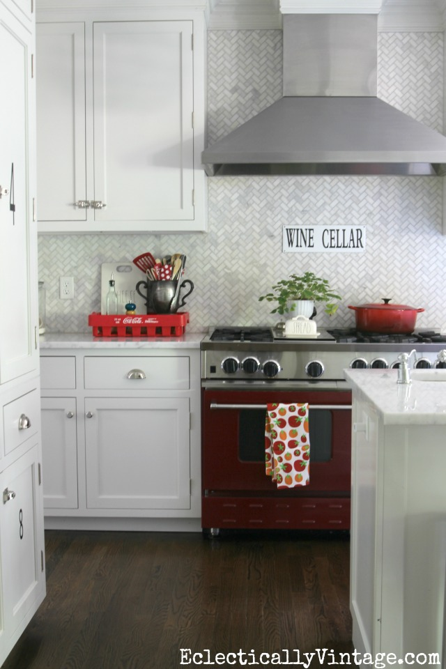 Gorgeous white kitchen with carrara marble herringbone tile backsplash kellyelko.com