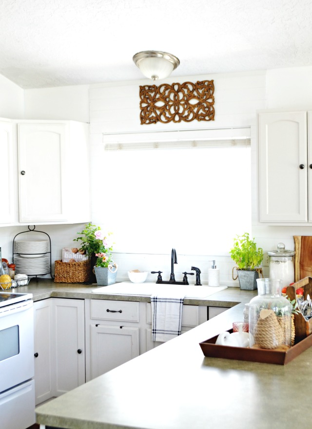 Love this white kitchen done on a budget kellyelko.com