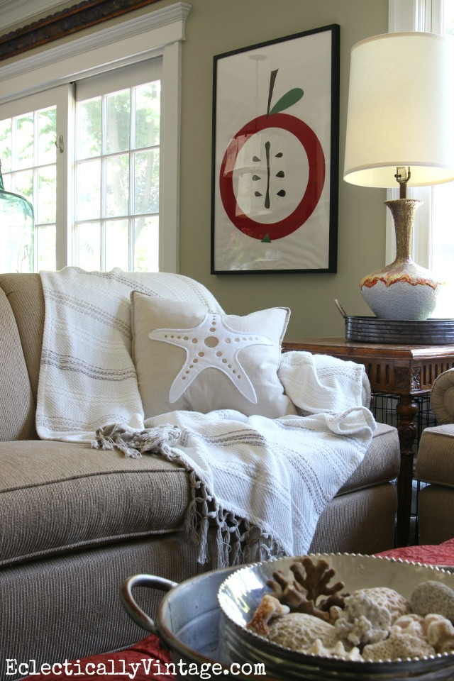 Love this cozy family room and that fun apple art! kellyelko.com