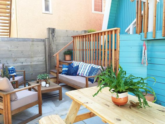 Small beach house patio - love the colorful blue house kellyelko.com