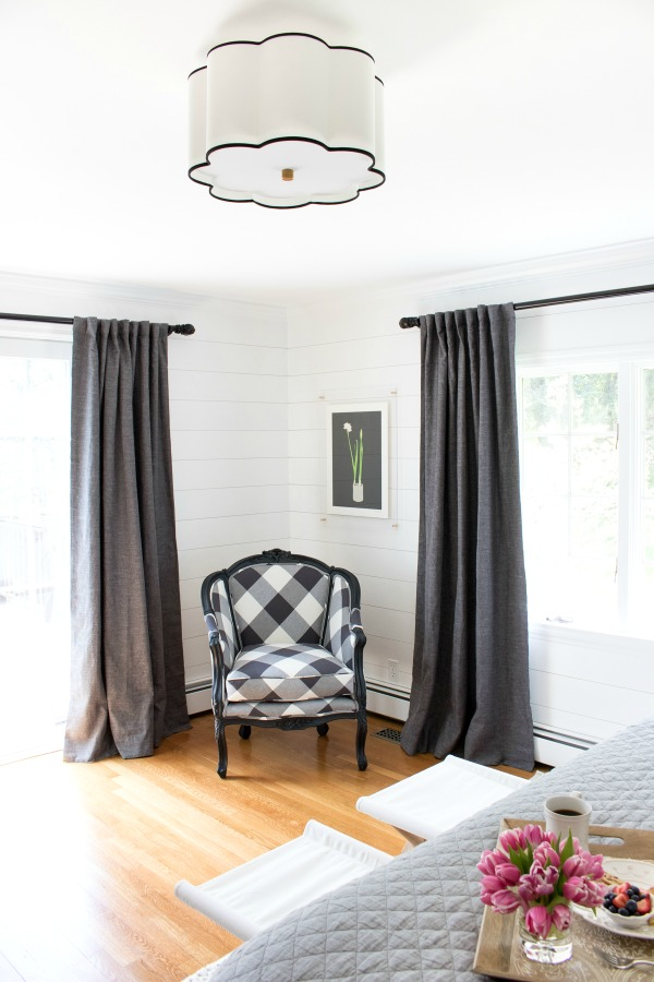 Love this gray, white and black bedroom - the oversized check fabric on the chair is gorgeous kellyelko.com