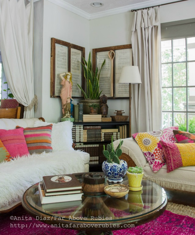 Boho chic family room - love the colorful pillows and wagon wheel table kellyelko.com