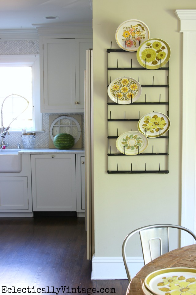 Love this bottle drying rack for displaying a fun collection of 1970s plates! kellyelko.com