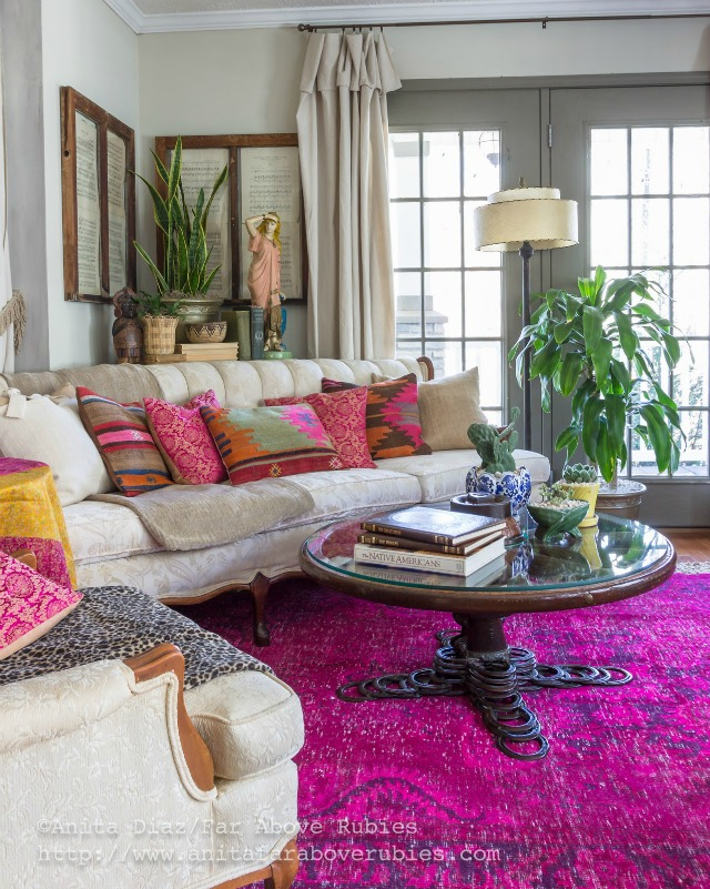 Colorful boho family room - love the over dyed pink rug kellyelko.com