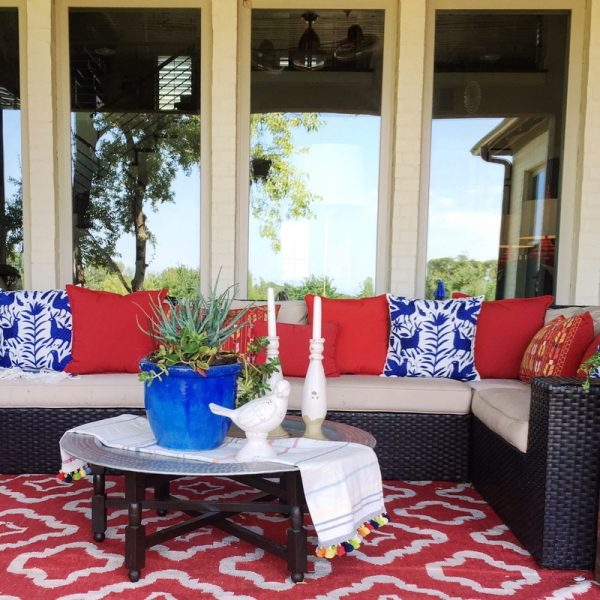 Colorful patio with comfortable sofa and Moroccan tray table kellyelko.com