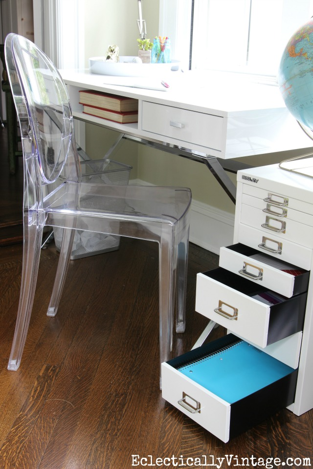 Love all the storage in this modern home office space and the clear ghost chair is beautiful kellyelko.com
