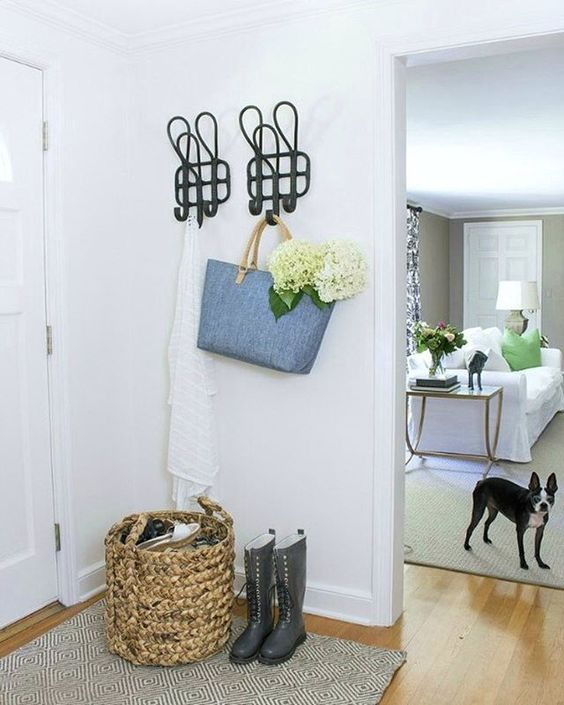 Love the oversized coat hooks in this white foyer kellyelko.com