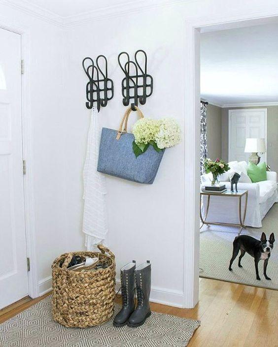 Love the oversized coat hooks in this white foyer kellyelko.com