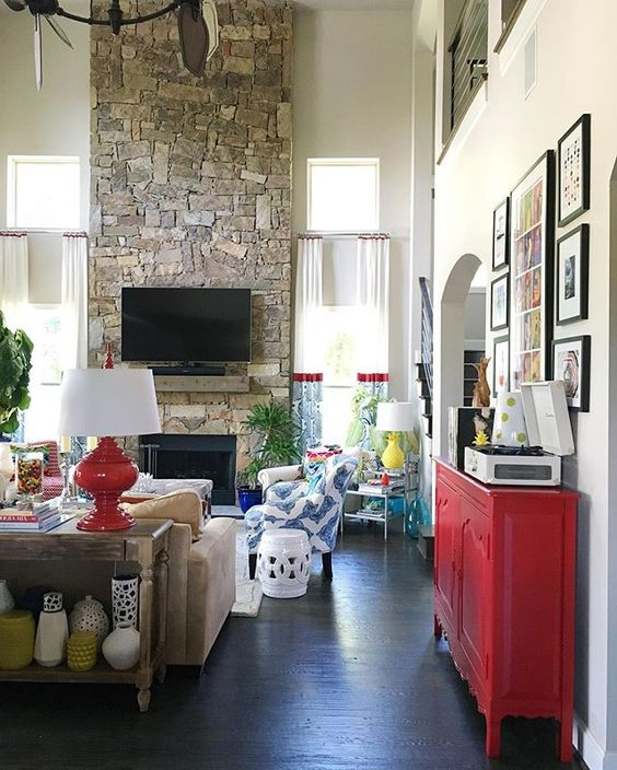 Love this huge stone fireplace in this colorful family room kellyelko.com