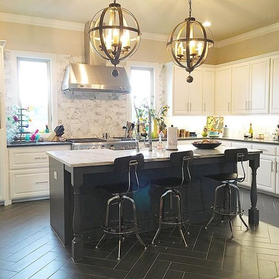 Black kitchen floors with marble backsplash and white cabinets is perfection! kellyelko.com