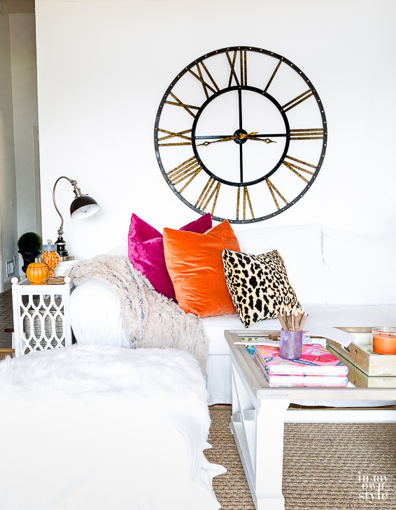 Love this giant clock and her fun mix of colorful pillows