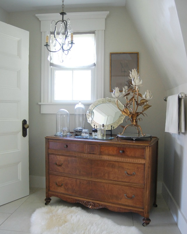 Antique wood chest in the bathroom adds warmth kellyelko.com