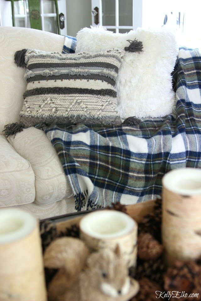Love the gray boho tassel pillow with blue plaid throw - so cozy! kellyelko.com