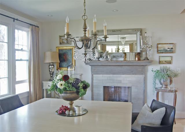 Antique mantel in the dining room kellyelko.com