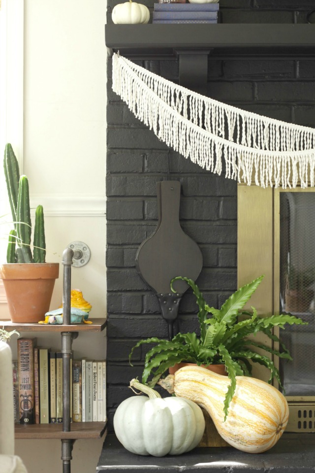 Love the fringe banner on this boho mantel kellyelko.com