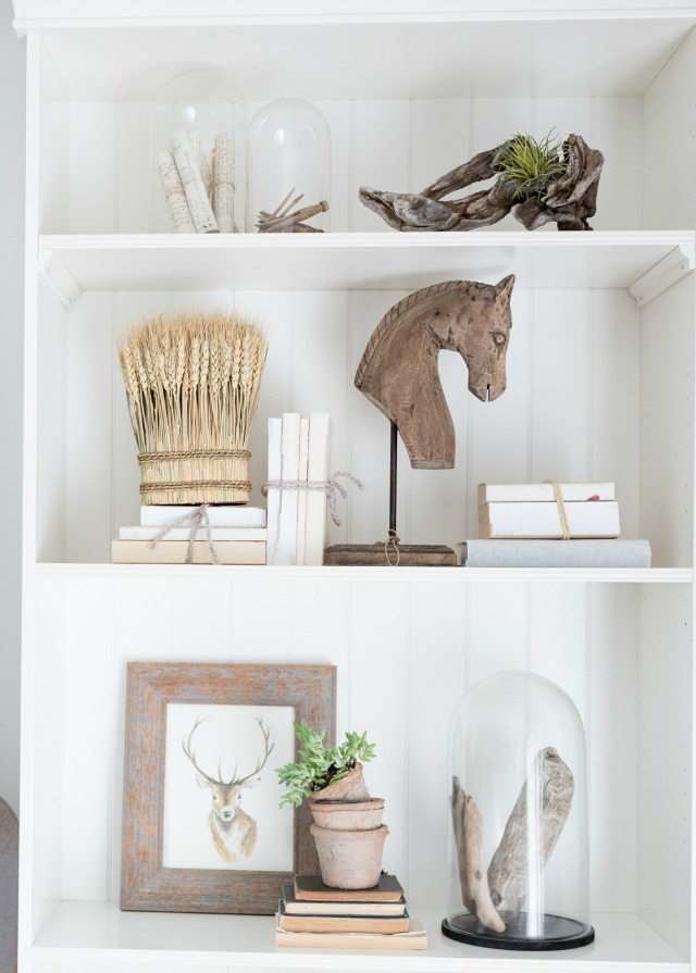 Styled shelves with rustic wood and cloches kellyelko.com
