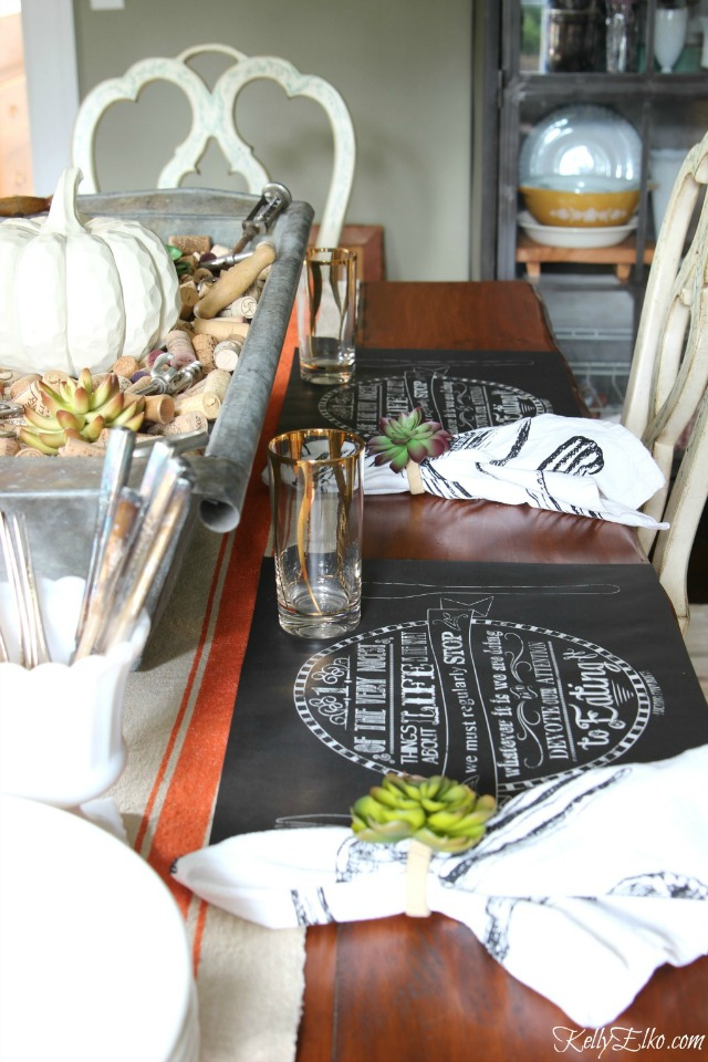 Gorgeous fall table setting - love the chalkboard placemats and cork centerpiece! kellyelko.com