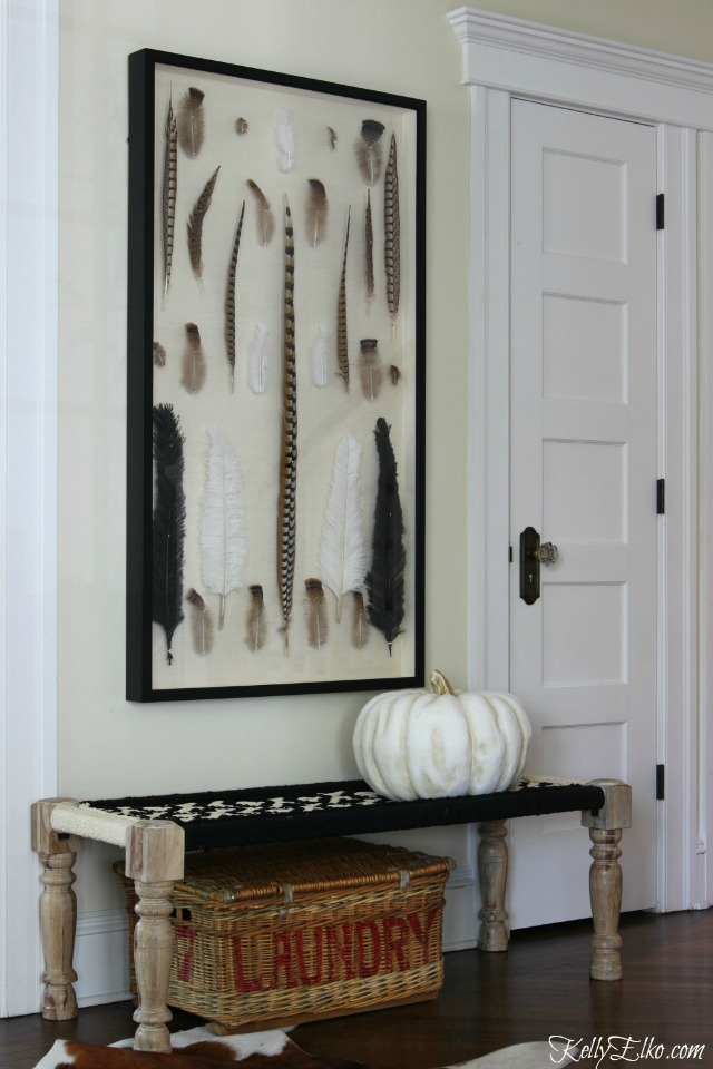Love the giant feather shadowbox and black and white woven bench kellyelko.com