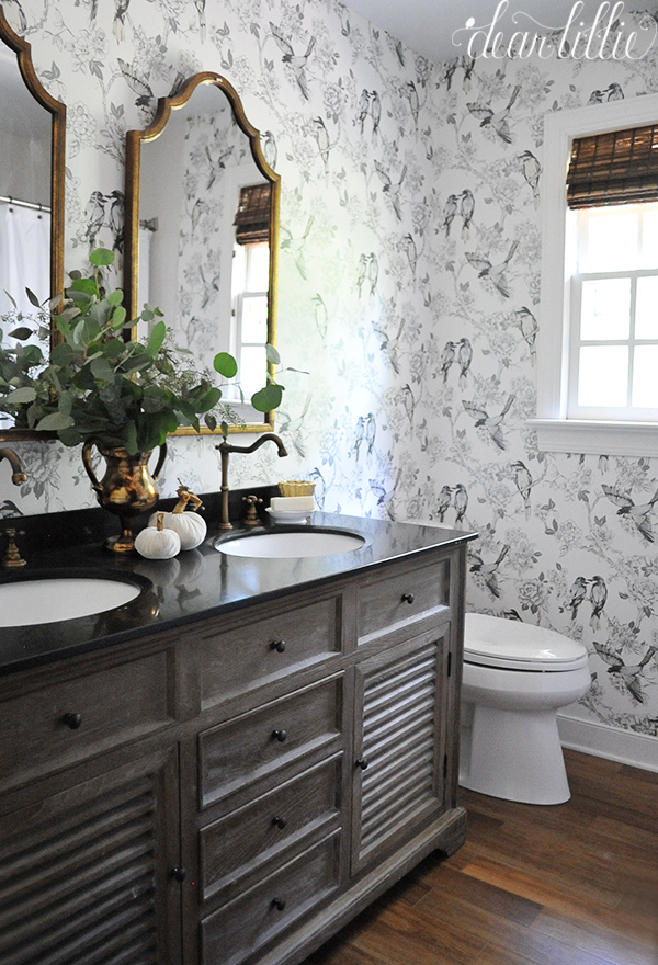Love this fun bird wallpaper in this gray and white bathroom kellyelko.com