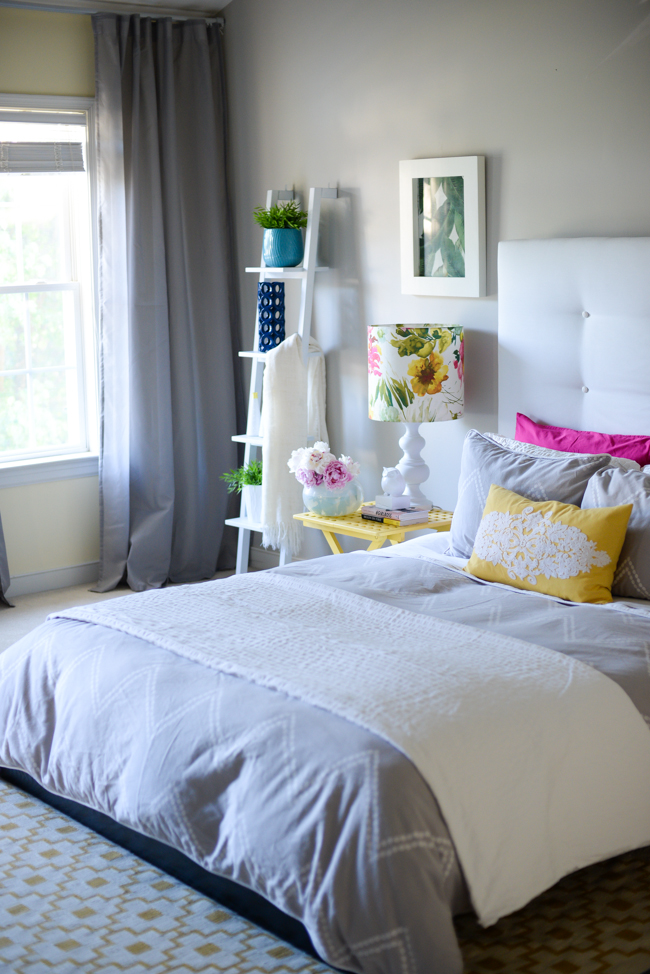 Modern gray bedroom - love the colorful pillows kellyelko.com