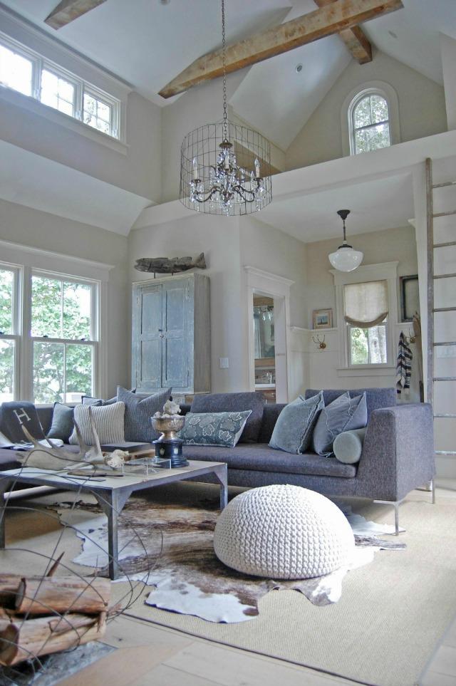 Modern and rustic living room - love the wood beams and warm cowhide kellyelko.com