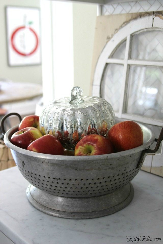 Vintage colander with apples and mercury glass pumpkin kellyelko.com