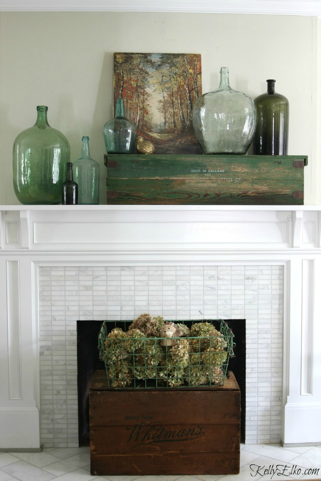 Fall mantel - love the collection of demijohns and the vintage wood box as a fireplace screen kellyelko.com