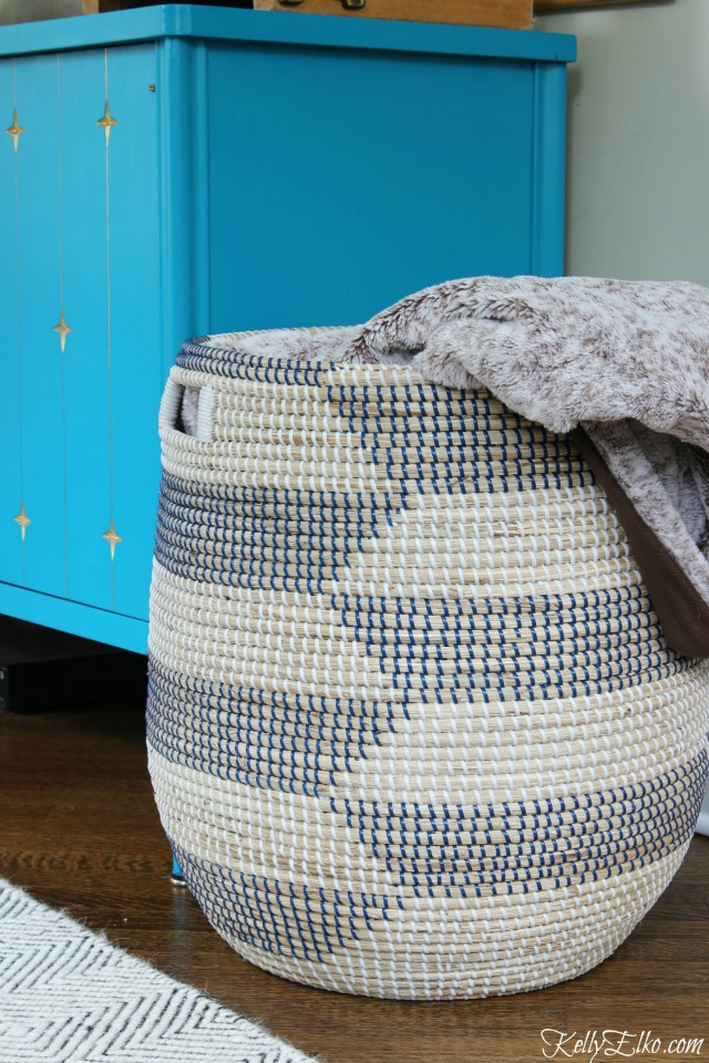 Woven basket is perfect for storing blankets and throws kellyelko.com